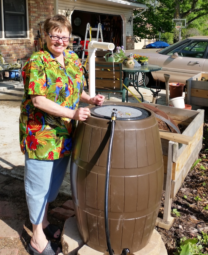DuckArea_2017May12_Sharon Ziegler with rain barrel smiling.jpg